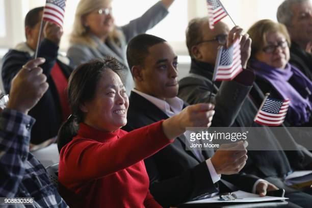 New American citizens celebrate during a naturalization service on January 22 2018 in Newark New Jersey Although much of the federal government was...