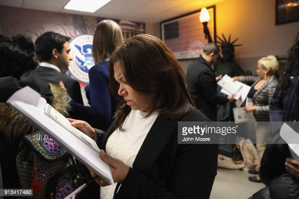 New American citizens check their US citizenhip certificates following a naturalization ceremony on February 2 2018 in New York City US Citizenship...