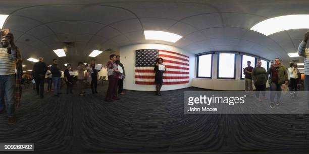 New American citizens pose for photos following a naturalization service on January 22 2018 in Newark New Jersey Immigrants from 32 different...