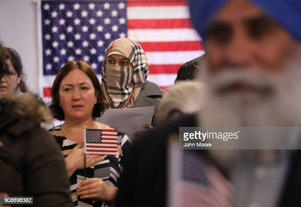 New American citizens recite the pledge of allegiance to the United States at a naturalization service on January 22 2018 in Newark New Jersey...