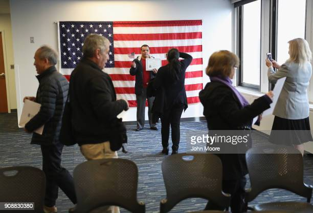 New American citizens take snapshots follwing a naturalization service on January 22 2018 in Newark New Jersey Although much of the federal...