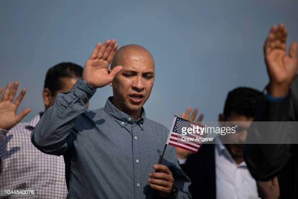 New American citizens take the Oath of Citizenship during a naturalization ceremony at Liberty State Park October 2 2018 in Jersey City New Jersey 35...
