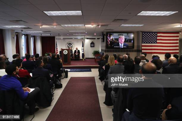 New American citizens watch a congradulatory video from President Trump at a naturalization ceremony on February 2 2018 in New York City US...