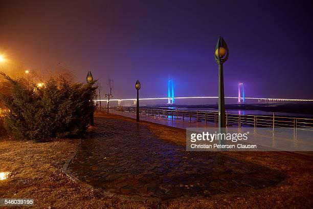 new amrok river bridge to north korea - yalu river stock pictures, royalty-free photos & images