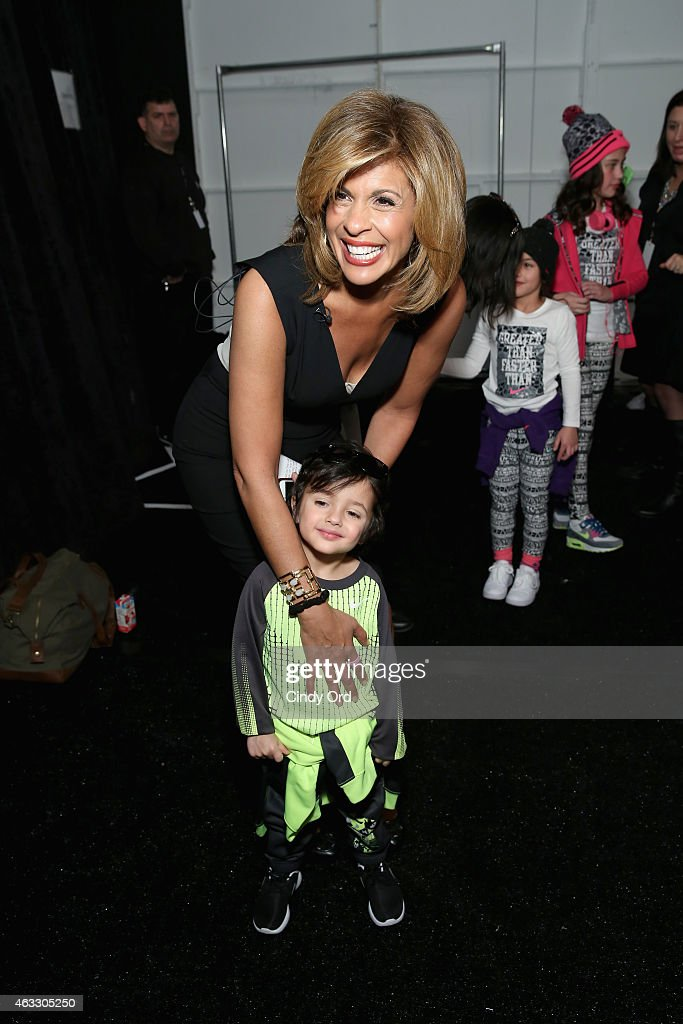 New anchor Hoda Kotb poses backstage with a model at the Nike Levi's Kids fashion show during Mercedes-Benz Fashion Week Fall 2015 at The Salon at Lincoln Center on February 12, 2015 in New York City.