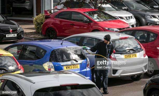 New and nearly new cars are displayed for sale on a forecourt of a car dealership on September 14 2017 in WestonsuperMare England Over 80 percent of...