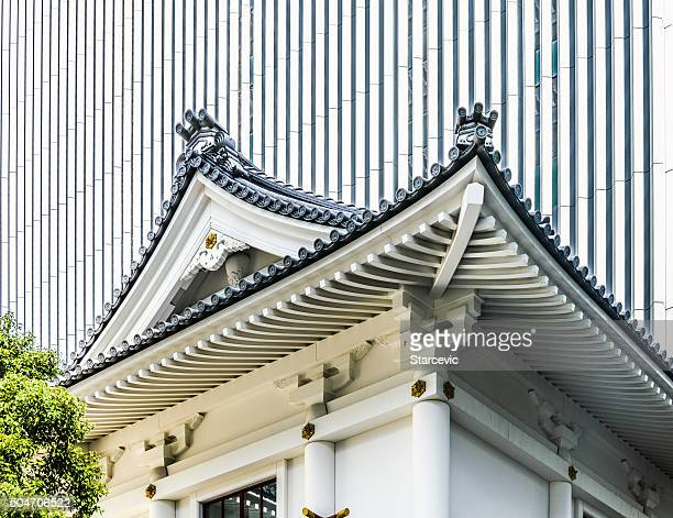 new and old architecture contrast - kabukiza theater in toyko - kabuki za stock photos and pictures