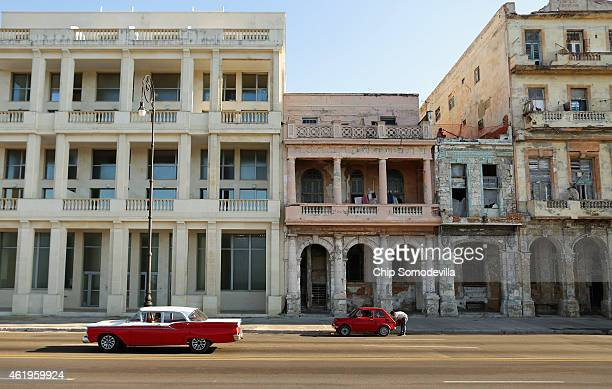 New and old buildings stand next to each other the Malecon oceanfront drive January 21 2015 in Havana Cuba Cuba and the United States are holding...