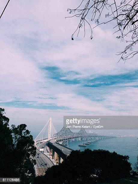 new and old eastern spans of the bay bridge - new bay bridge stock pictures, royalty-free photos & images