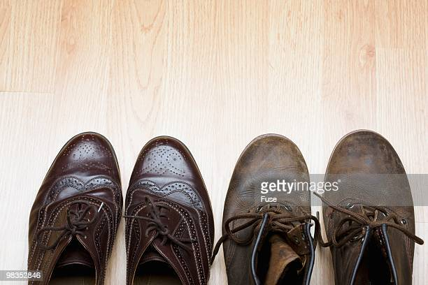 new and old shoes side by side - prosperity stock photos and pictures