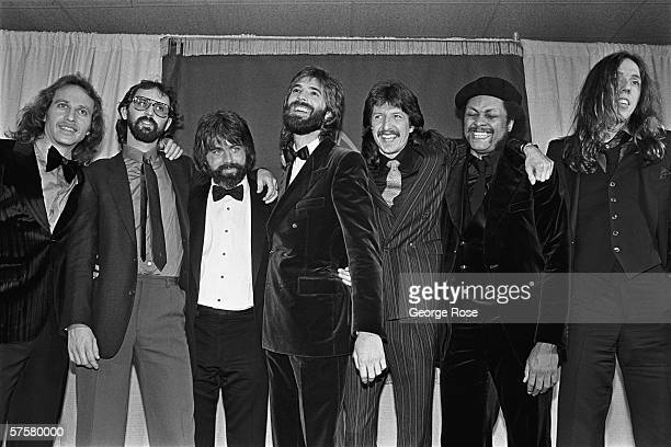 New and older members of The Doobie Brothers Tom Johnston, John Hartman, Michael McDonald, Kenny Loggins, Pat Simmons, pose back stage with Kenny...