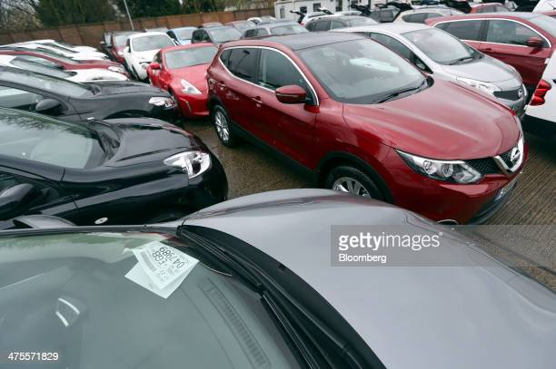 New and second hand Nissan automobiles produced by Nissan Motor Co stand parked on the forecourt of a new car showroom in Romford UK on Friday Feb 28...