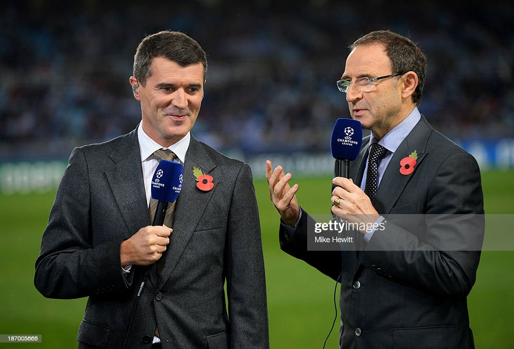 New announced Republic of Ireland manager Martin O'Neill (R) and his assistant Roy Keane speak during the UEFA Champions League Group A match between Real Sociedad de Futbol and Manchester United at Estadio Anoeta on November 5, 2013 in San Sebastian, Spain.