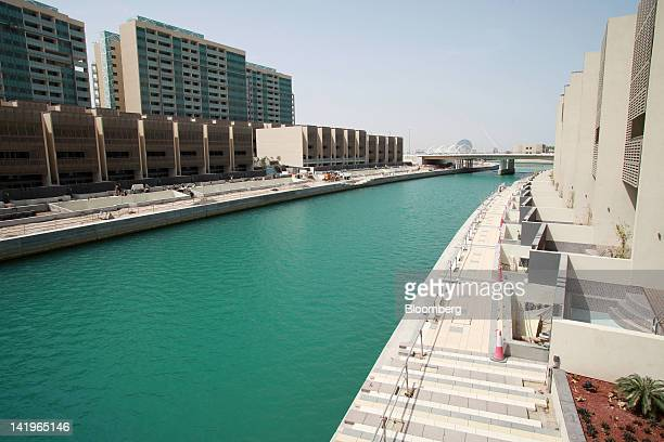 New apartment blocks are seen beside a waterway at the Al Muneera development during a media tour organized by Aldar Properties PJSC Abu Dhabi's...