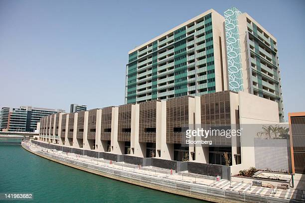 New apartment blocks stand by a waterway at the Al Muneera development during a media tour organized by Aldar Properties PJSC Abu Dhabi's biggest...