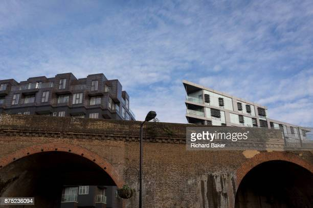 New apartment homes rise above a Victorian railway bridge in Southwark on 13th November 2017 in London England