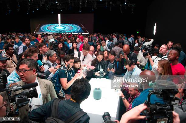A new Apple HomePod smart speaker is surrounded by members of the media during Apple's Worldwide Developers Conference in San Jose California on June...