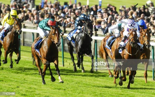 New Approach ridden by Kevin Manning beats Fast Company and Ted Durcan to win The Darley Dewhurst Stakes at Newmarket Racecourse on October 20 2007...