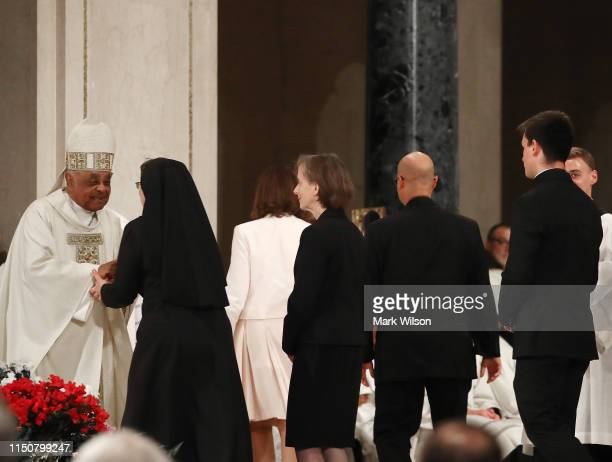 New Archbishop of Washington Wilton D Gregory greets guests during his Installation mass at the National Shrine of the Immaculate Conception on May...