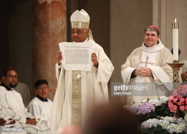 New Archbishop of Washington Wilton D Gregory holds his Apostolic Mandate during his Installation mass at the National Shrine of the Immaculate...