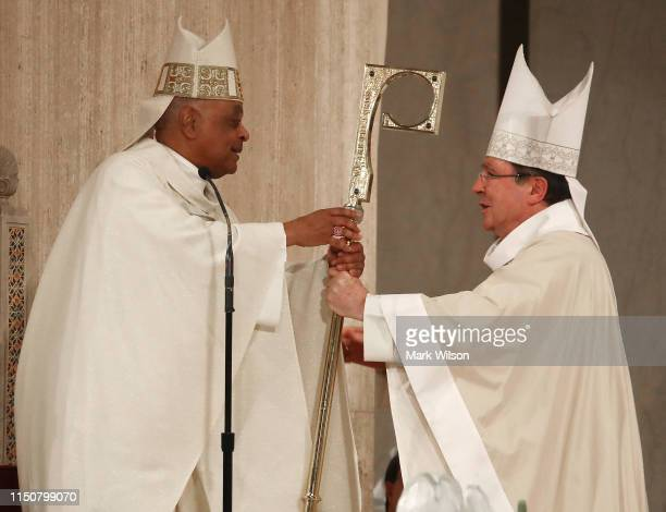 New Archbishop of Washington Wilton D Gregory is presented with his Crosier from Archbishop Christophe Pierre during his Installation mass at the...