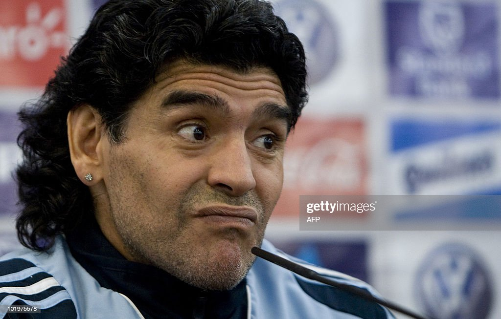 New Argentina coach Diego Maradona attends a press conference in Glasgow, on November 18, 2008. Diego Maradona says he cannot understand why Terry Butcher continues to harbour a grudge over the 'Hand of God' goal that helped knock England out of the 1986 World Cup. Butcher, an England defender in the team that lost the quarter-final match and now Scotland's assistant manager, said on Monday that he would never 'forgive and forget' Maradona's action and made it clear he was unlikely to shake the new Argentina coach's hand when the Scots face his new charges on Wednesday. AFP PHOTO/ Michael Hughes