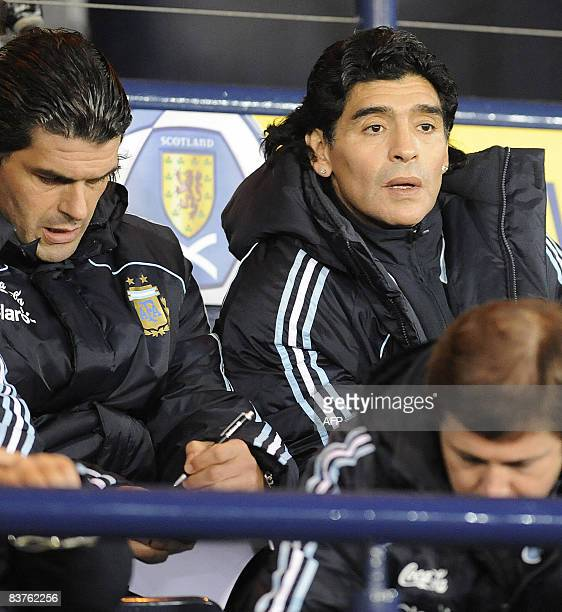 New Argentina coach Diego Maradona gestures during a friendly football match against Scotland on November 19, 2008 at Hampden Park in Scotland. AFP...