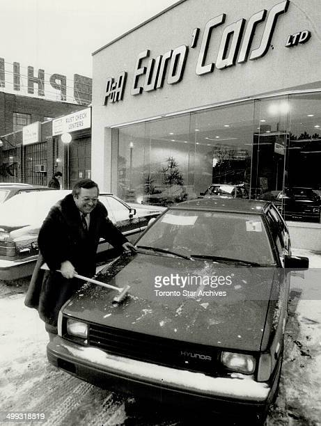 New arrival Hyundai dealer Phil Lacasse cleans up one of the new Excel cars that have just arrived at his showroom Dealers hope the fourdoor...