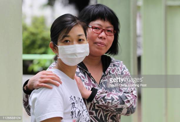 New arrival parent from the mainland Ms Fung and volunteer Tiffany Lau Ngayee age 38 pose for picture after the Against Child Abuse press conference...