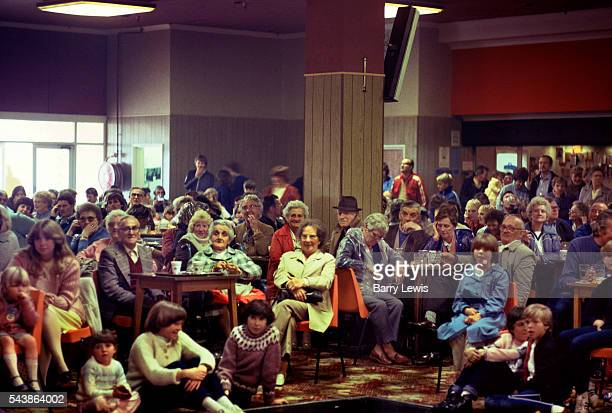 New arrivals wet from the rain gather in the bar for instructions at Butlins Holiday camp in Skegness Butlins Skegness is a holiday camp located in...
