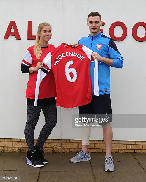 New Arsenal Ladies signing Anouk Hoogendijk poses with men's captain Thomas Vermaelen at London Colney on January 15 2014 in St Albans England