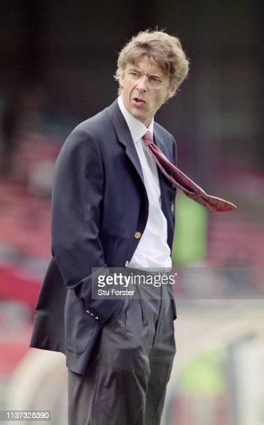 New Arsenal manager Arsene Wenger looks on before the Premier League match against Wimbledon at Selhurst Park on November 2, 1996 in London, United...