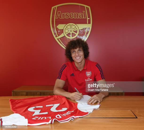 New Arsenal signing David Luiz signs his contract at London Colney on August 08, 2019 in St Albans, England.