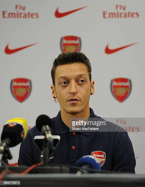 New Arsenal signing Mesut Oezil attends a press conference at London Colney on September 12, 2013 in St Albans, England.