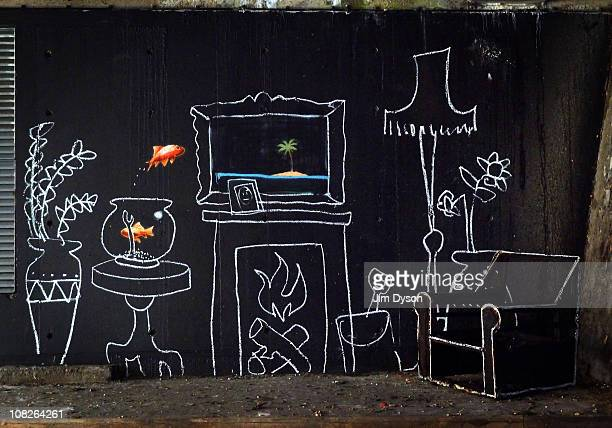A new artwork attributed to guerrilla graffiti artist Banksy which shows a goldfish leaping from it's bowl in a chalkdrawn living room scene is...