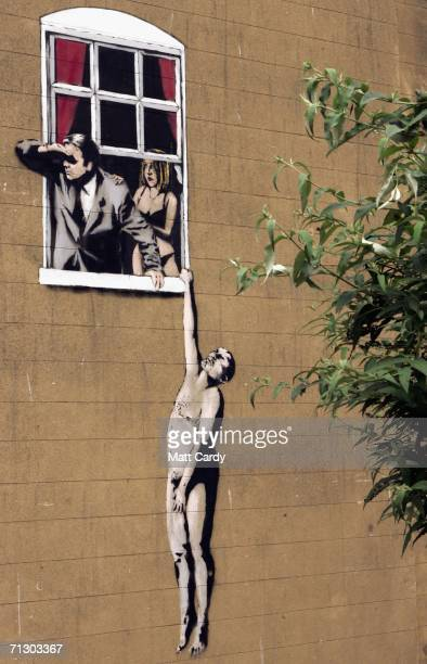 New artwork by the celebrated graffiti artist Banksy adorns a building on June 27 2006 in Bristol, England. The large graffiti image, depicting a...