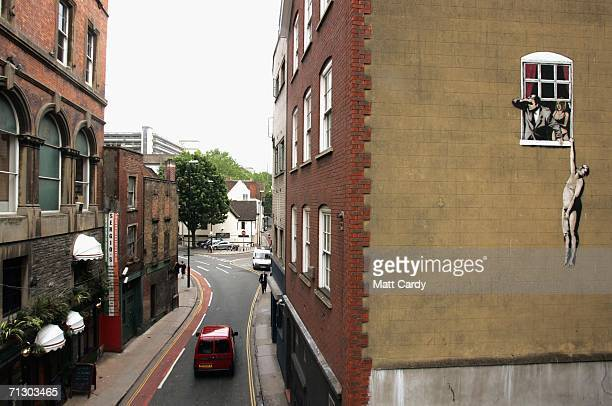 New artwork by the celebrated graffiti artist Banksy adorns the side of building, on June 27 2006 in Bristol, England. The large graffiti image,...