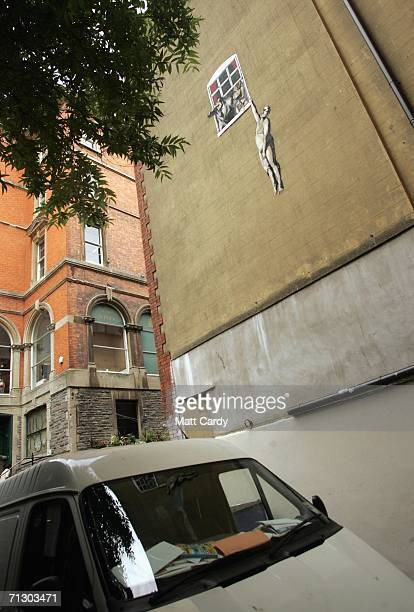 A new artwork by the celebrated graffiti artist Banksy adorns the side of building on June 27 2006 in Bristol England The large graffiti image...