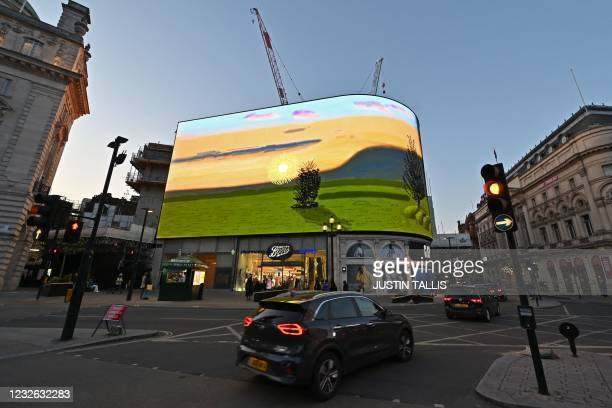 """New artwork from British artist David Hockney entitled """"Remember you cannot look at the sun or death for very long"""" is displayed on large screens at..."""