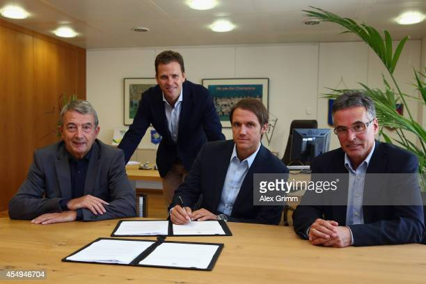 New assistant coach Thomas Schneider of the German national football team poses with DFB President Wolfgang Niersbach team manager Oliver Bierhoff...