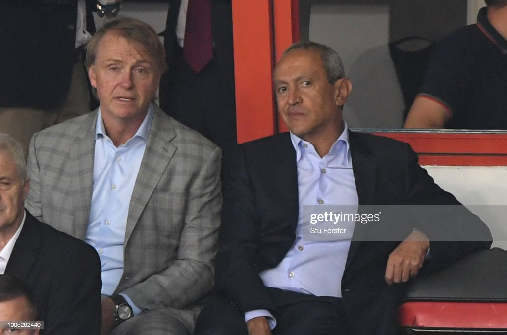 New Aston Villa owners Nassef Sawiris (r) and Wes Edens look on during a friendly match between Aston Villa and West Ham United at Banks' Stadium on July 25, 2018 in Walsall, England.