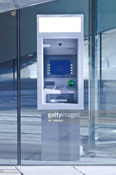 New ATM cash machine setup in glass wall