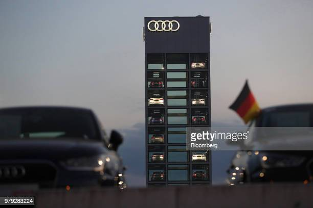 The Audi AG logo sits illuminated on the automaker's showroom at night in Berlin Germany on Tuesday June 19 2018 Volkswagen AG named Bram Schot as...