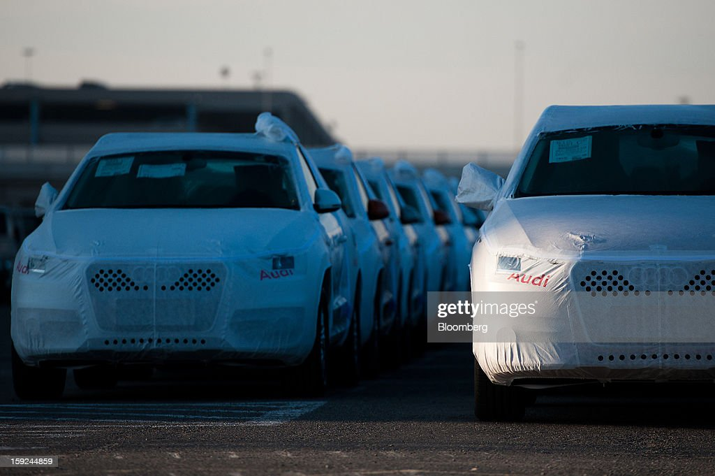 New Audi AG automobiles stand beneath protective covers in a parking lot ahead of shipping at Barcelona port in Barcelona, Spain, on Thursday, Jan. 10, 2013. Spanish exports grew the least in five months in September as the euro area relapsed into a recession and the region's fourth-largest economy continued to contract. Photographer: David Ramos/Bloomberg via Getty Images