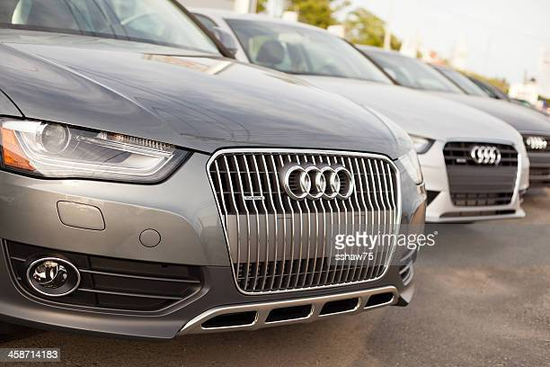 new audi cars at dealership - audi a4 stock photos and pictures
