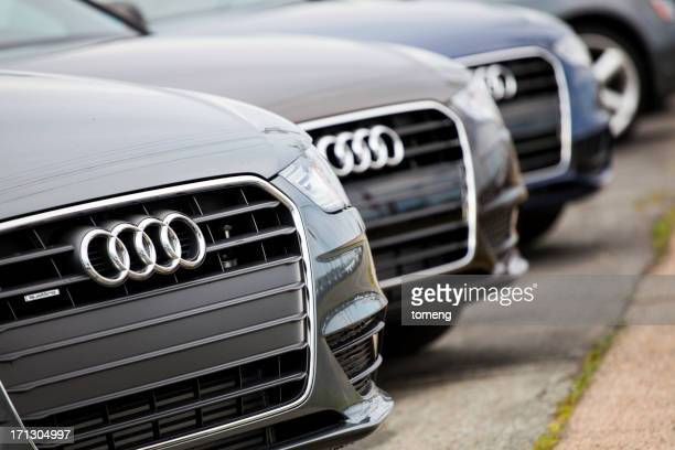 new audi vehicles in a row - audi car stock photos and pictures
