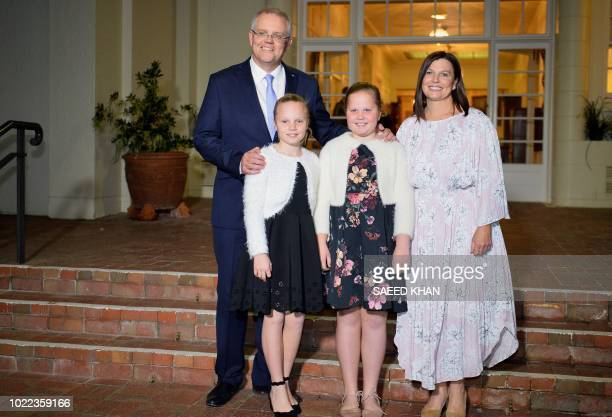 New Australian Prime Minister Scott Morrison poses for photos with his wife Jenny Morrison and their two daughters Abbey and Lily as they arrive at...
