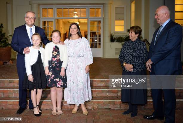 New Australian Prime Minister Scott Morrison poses for photos with his wife Jenny Morrison and their two daughters Abbey and Lily as Australia's...