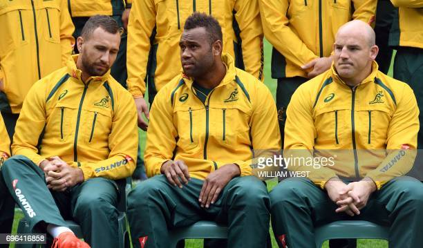 New Australian winger Eto Nabuli sits with teammates Quade Cooper and Stephen Moore on during the team's Captain's Run in Sydney on 16 June 2017...