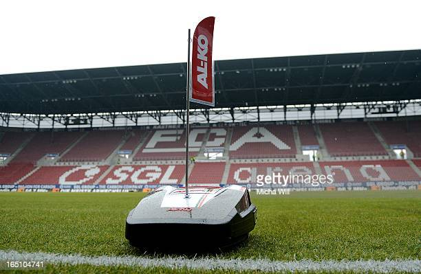 New automatic mowing machines are cutting the grass prior to the Bundesliga match between FC Augsburg and Hannover 96 at SGL Arena on March 30 2013...